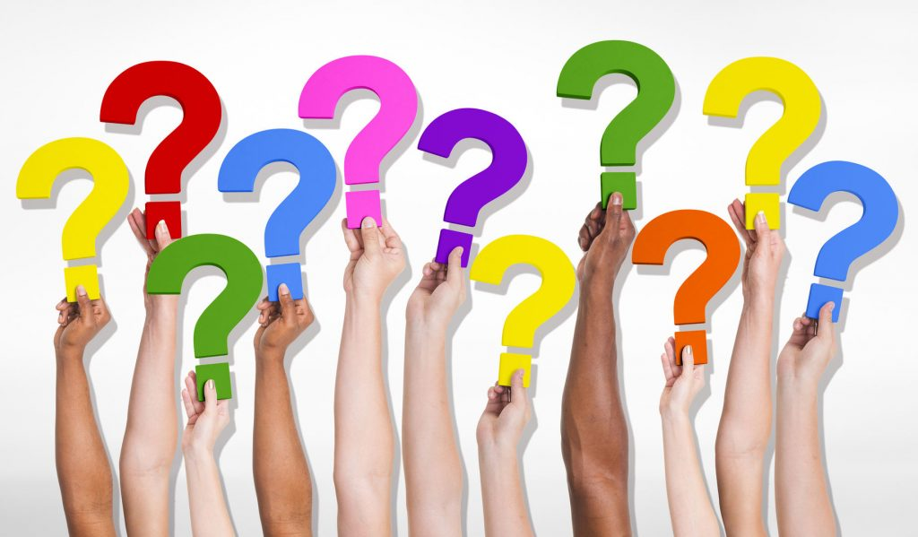 11 question marks being held up - illustrates that we answer all questions.